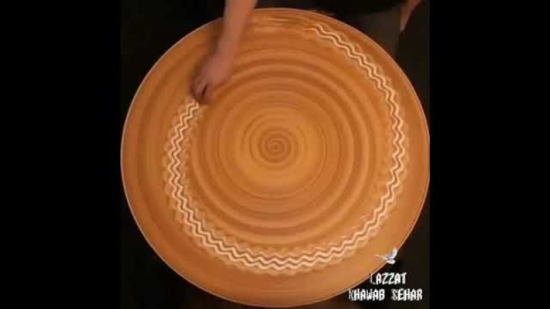 Russian artist Mikhail Sadovnikov uses his bare hands to create hypnotizing patterns on wet clay.