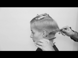 Short round graduated haircut with discconnection scissor over comb