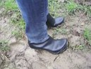 High Heel Plateau Boots outdoor on a muddy field
