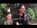 """Jewgenij Poddubnyj mit dem """"vergasten Jungen Hassan Diab und dessen Vater in Duma"""