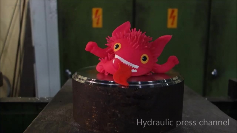 Crushing rubber duck with hydraulic press