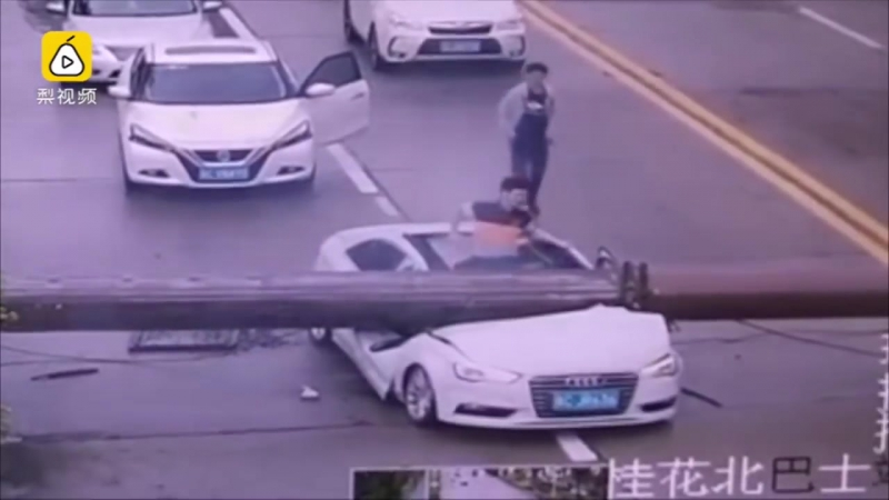 Narrow escape- driver miraculously survived after his car smashed by falling crane on road