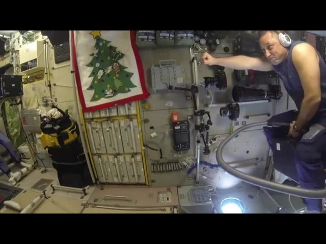 Russian astronaut flying on a vacuum cleaner in ISS