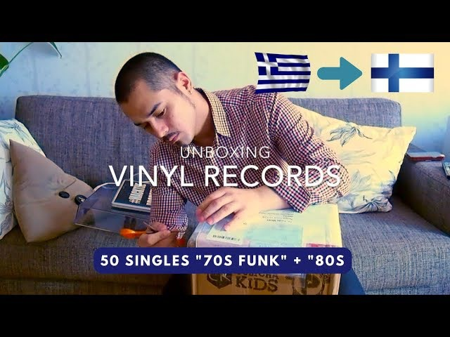 Unboxing Vinyl Records: 50 Singles