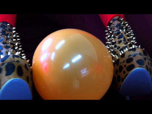 Belle Fatale Pops an Orange Balloon with her spikey shoes