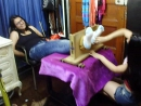 Patricia tickles Milagros feet in the stocks FF