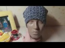 Вязаная универсальная шапочка биниспицами