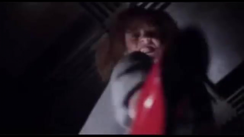 Fiona Dourif stomps a man's head in the 2017 movie Cult Of Chucky.
