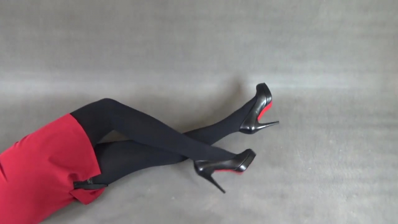 Black high heels and red skirt