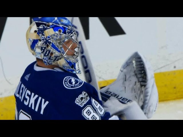 Andrei Vasilevskiy stretches across to rob Nick Schmaltz
