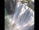 Miles Daisher на мотопараплане над Shoshone Falls State Park в США