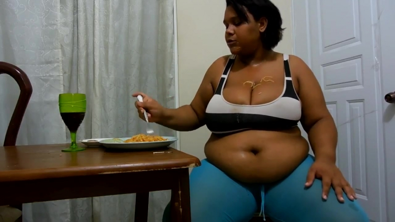 South American Busty woman stuffing her belly