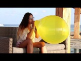 Yellow Tuftex 17'' balloon blow to pop