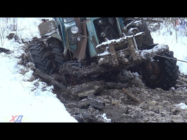 MTZ 82 trying to freeze the way for the removal of wet woods | Fragile ice
