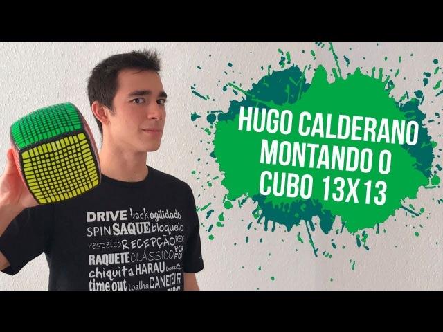 Hugo Calderano montando o Rubik's cube 13x13