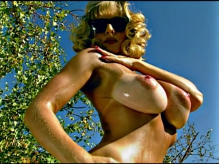 Milf  Oiled Down In The Bright Sunshine