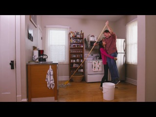 The Power Of Love: Wife Lifts Husband Into The Air So That He Has Room To Use His Very Long Mop
