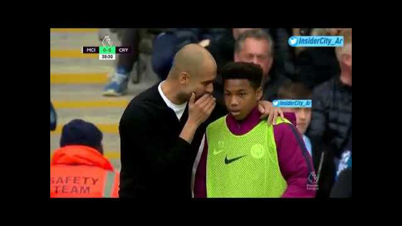 Guardiola getting a ball boy to pass on tactical instructions to Kyle Walker.