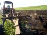 MTZ 952.3 with 4 row plought