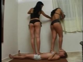 2 girls sit on 1 girl