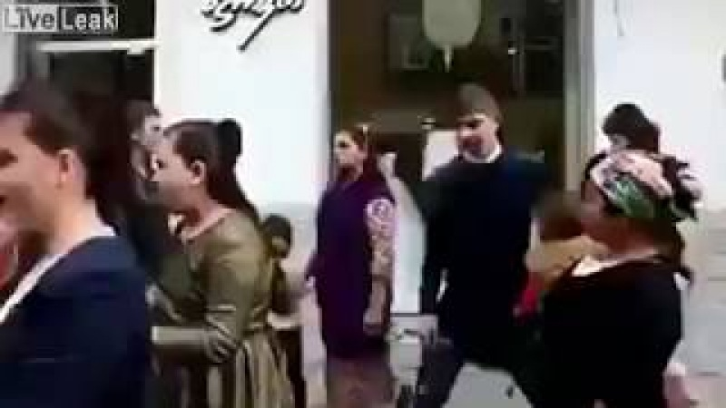 Woman uses a child as a weapon to hit another man