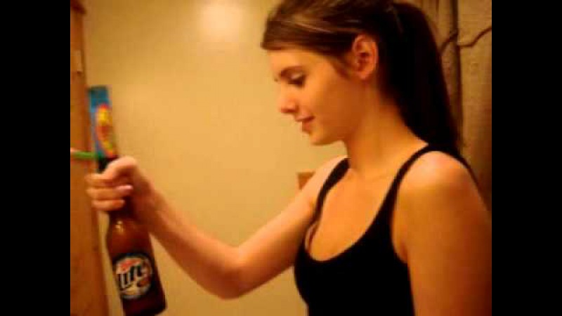 Beautiful really hot cute sexy girl Shows how to drink beer