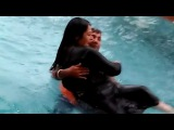 Piggyback husband and wife in swimming pool