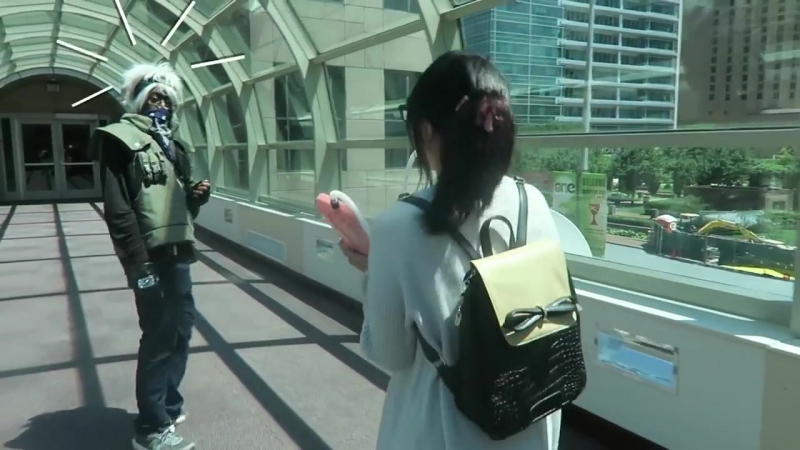 Playing the melodica while following random cosplayers