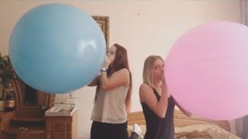 Cute girls blowing to pop really large balloons with obnoxious piano music