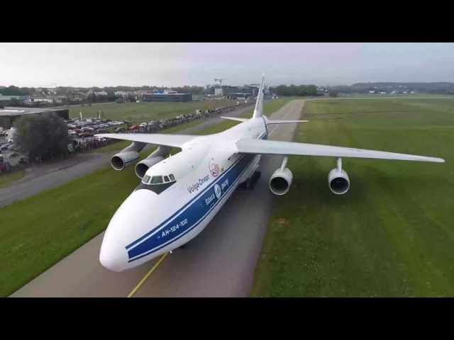 Antonov An-124 Ruslan Landing and carries another plane. Drone video