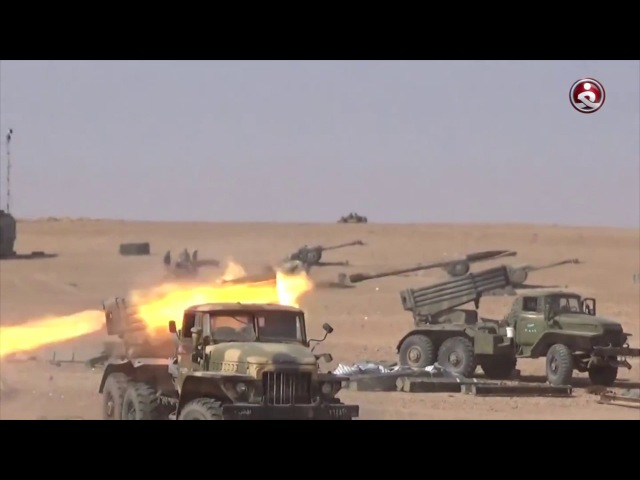 Al-Ghadir correspondent documents the moment of meeting of the Iraqi forces and crowd with the Syrian army on the border of the ...