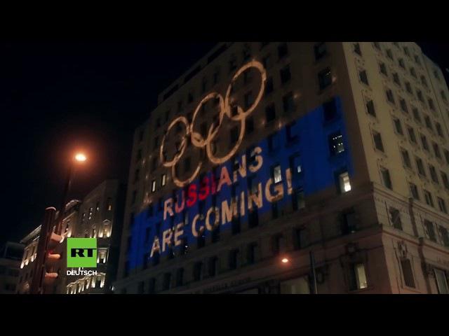 KANADA: SPORTFANS ZEIGEN FLAGGE UND TROLLEN WADA MIT LICHTSHOW FÜR RUSSISCHES OLYMPIATEAM.