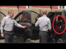 Russian leader Vladimir Putin opens car door for mysterious lady in red