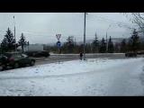 В Красноярске дорожники косят траву под снегом