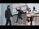 Tom Cruise takes to the sky as he stops traffic during filming in London for Mission Impossible