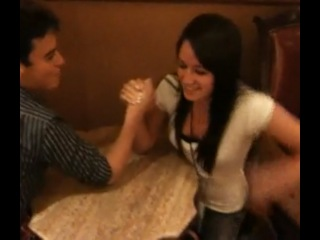 Guy gets crushed arm wrestling cheerleader.