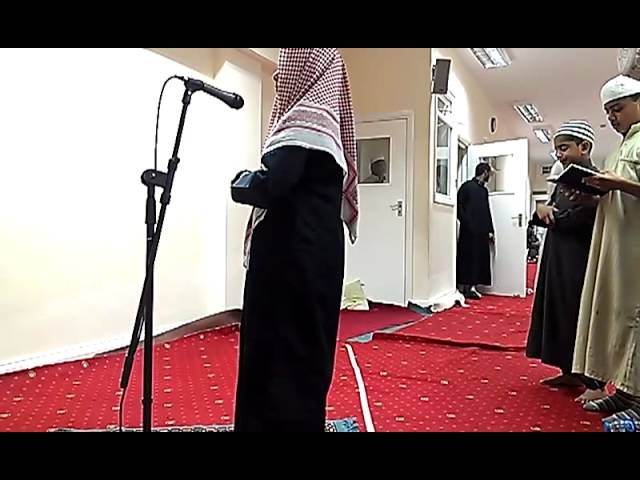 Young boy reads like Mahir Al Muaiqly