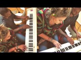 Paris Jackson playing piano with Austin Brown