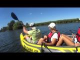 Three persons kayaking on Intex Explorer K2. Moscow region