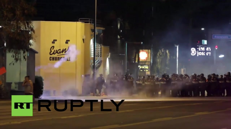 USA- Helicopters and tear gas dog anti-police brutality demo in Phoenix