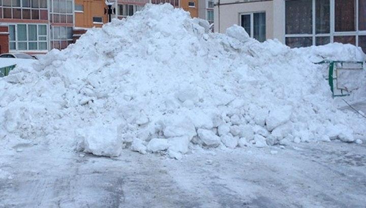 Власти просят томичей помочь в борьбе с незаконными снегоотвалами