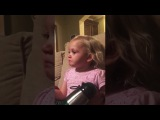 2 year old girl watching a movie and crying because the dinosaur fell and lost his mom...
