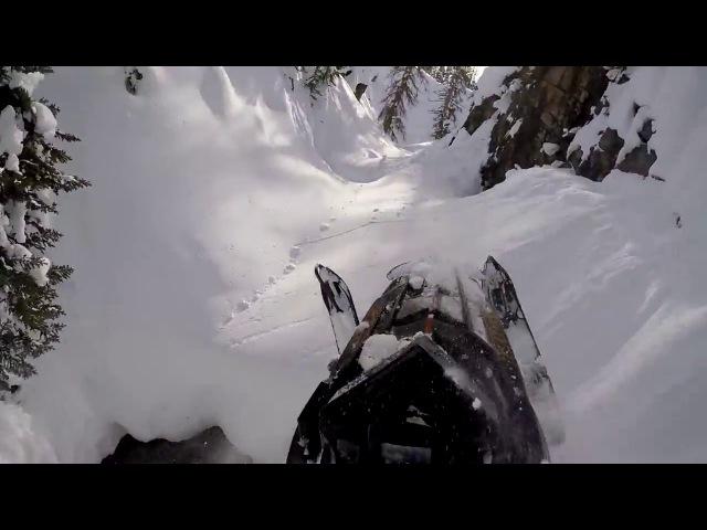 Insane snowmobile rider, takes some crazy routes