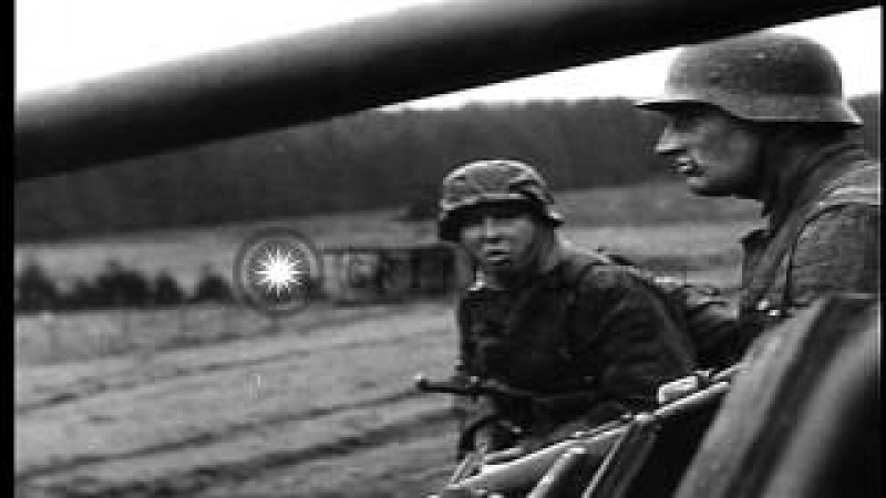 German soldiers smoke American cigarettes under wrecked US armored car near Pote...HD Stock Footage