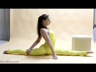 Flexible gymnast in hot spandex bodysuit
