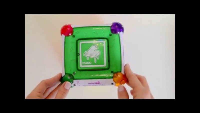 Развивающая игрушка Волшебный куб Моцарт MUNCHKIN. Munchkin Mozart Magic Cube.