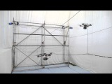 Building a rope bridge with flying machines