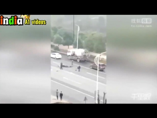 Two people on a motorcycle crashes into a truck then gets run over by a cement truck, both dead