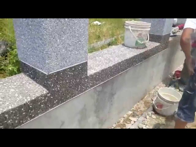 Cement rendering with small stones on brick walls
