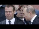 Путин и Медведев насквозь промокли под ливнем на церемонии в День памяти и скорби
